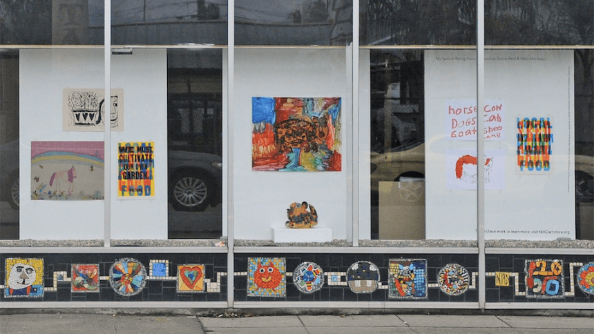 Installation View of an exhibition including ceramics, prints, paintings, and mixed media works in NIAD Windows, My Rising Special Place selected by Mary Mortimer and Dorrie Reid