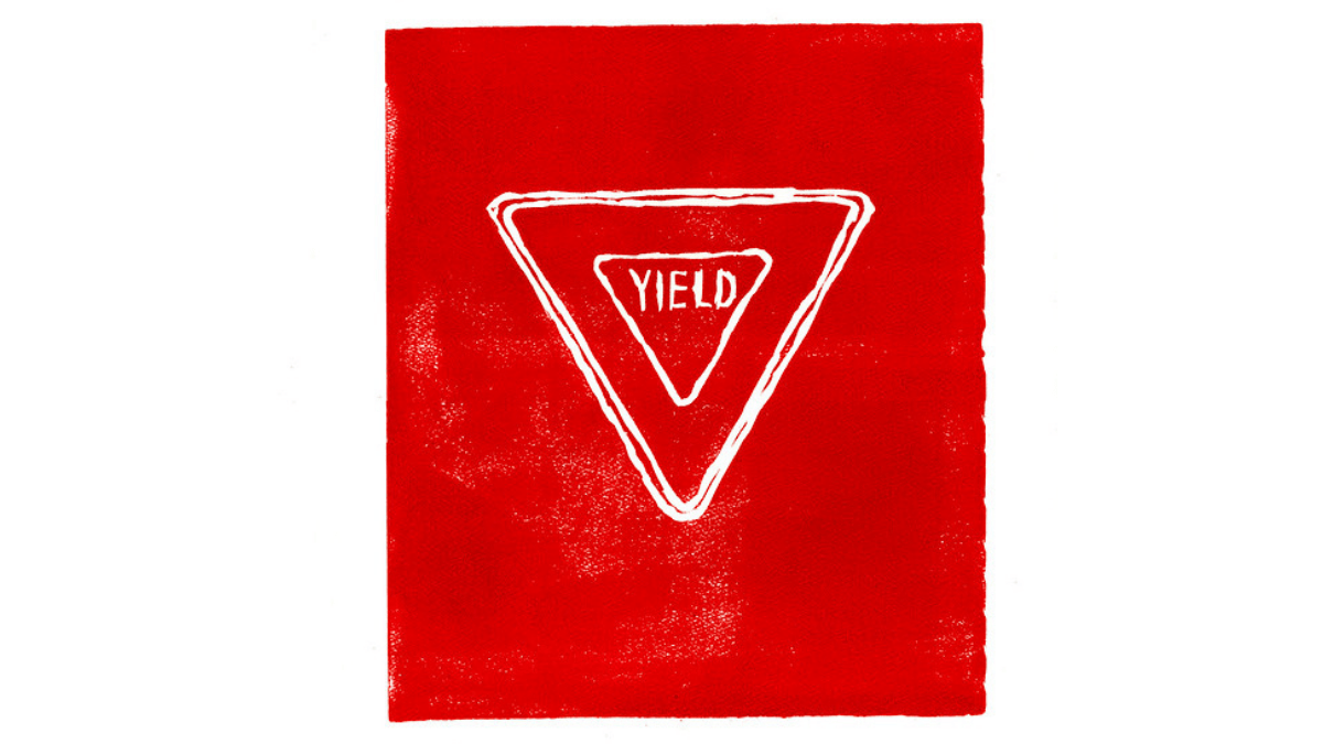 A linocut print with a slightly rough right edge. the ink is fire-engine red with very lightly speckled patches of white paper showing through here and there. in the upper center of the page, the word YIELD in handdrawn letters is tightly enclosed by an upside-down triangle, with is in turn enclosed by another upside down triangle, with a third triangle tight around the second. The borders of the two outer triangles blend together here and there.